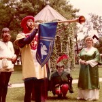 I've always loved the medieval period. As a member of the Society for Creative Anachronism, I was a herald, announcing and watching closely the field of battle. That's me, in the middle, down low for a better look.